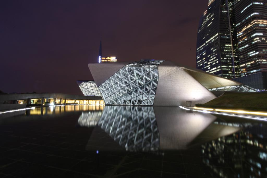 Guangzhou City Guide The Art of Travel Guangzhou Opera House Zaha Hadid exterior reflection